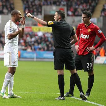 Ashley Williams, left, and Robin van Persie, right, clashed at the Liberty Stadium