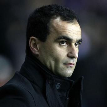 Roberto Martinez, pictured, has praised the work done by David Moyes at Everton
