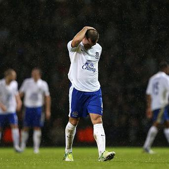 Darron Gibson looks dejected as he walks from the field after being sent off