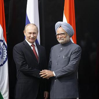 Russian president Vladimir Putin and Indian prime minister Manmohan Singh held talks in New Delhi (AP)