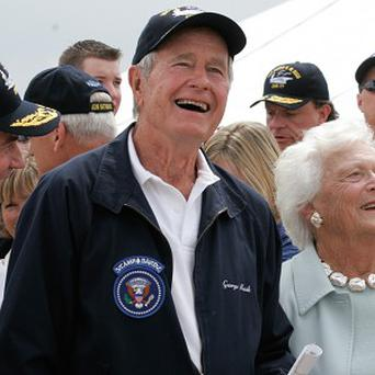 Former President George HW Bush is to spend Christmas in hospital (AP)