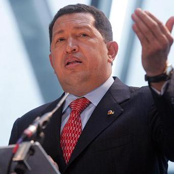 Venezuelan leader Hugo Chavez is said to be up and walking following cancer surgery in Cuba
