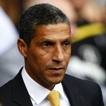Chris Hughton is expecting a stern test on Boxing Day against in-form Chelsea