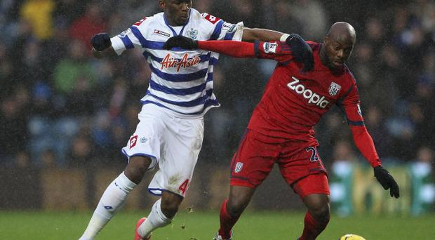 QPR's Stephane Mbia tackles West Bromwich Albion's Youssouf Mulumbu during the Barclays Premier League match at Loftus Road, London. PRESS ASSOCIATION Photo. Picture date: Wednesday December 26, 2012. See PA story SOCCER QPR. Photo credit should read: Phil Cole/PA Wire. RESTRICTIONS: Editorial use only. Maximum 45 images during a match. No video emulation or promotion as 'live'. No use in games, competitions, merchandise, betting or single club/player services. No use with unofficial audio, video, data, fixtures or club/league logos.