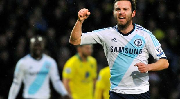 Chelsea's Juan Mata celebrates scoring against Norwich City during their English Premier League soccer match at Carrow Road in Norwich December 26, 2012. REUTERS/Toby Melville (BRITAIN - Tags: SPORT SOCCER) NO USE WITH UNAUTHORIZED AUDIO, VIDEO, DATA, FIXTURE LISTS, CLUB/LEAGUE LOGOS OR
