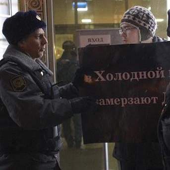 A protester argues with police officers outside the Federation Council in Moscow (AP)