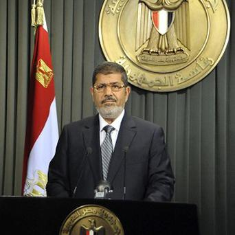 Egypt President Mohammed Morsi prepares to make a televised address to the nation in Cairo (AP)