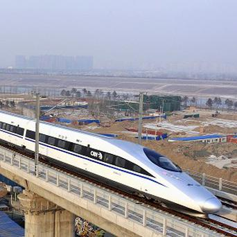 The new high-speed trains take approximately eight hours to travel from Beijing to Guangzhou (AP)