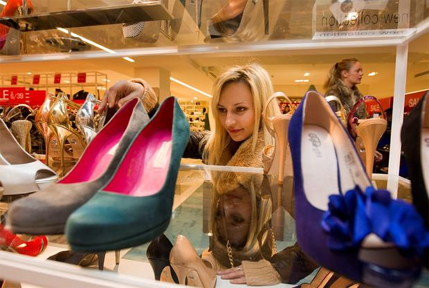 Tanya Luciove originally from Lithuania at the shoes department in Arnotts on Henry Street for the St. Stephen's Day Sales. Photo:Mark Condren