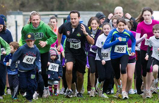 Minister for Transport, Tourism and Sport, Leo Varadkar and Senator Eamonn Coghlan who took part in the St Stephen's Day Goal Mile in Porterstown Park, Castleknock. Photo: Mark Condren