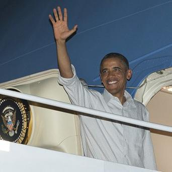 President Barack Obama boards Air Force One at Honolulu Joint Base Pearl Harbour-Hickam, en route to Washington in 2012 (AP)