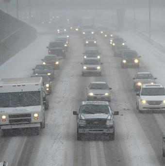 Cars make their way slowly on the Interstate 696 near Central Park Boulevard in Southfield, Michigan (AP)