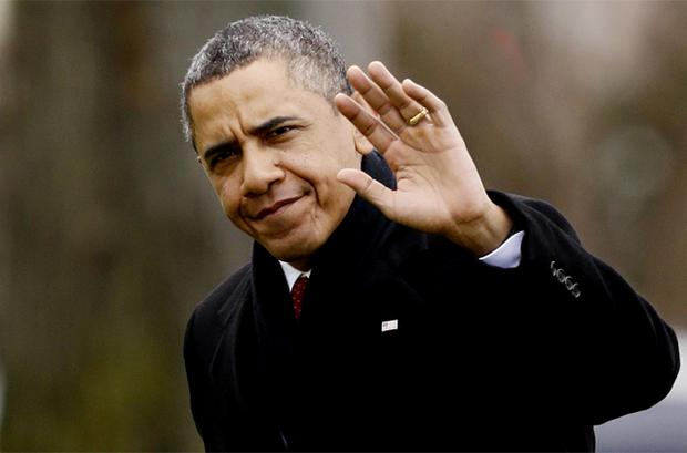 President Barack Obama waves to reporters as he steps off the Marine One helicopter and walks on the South Lawn at the White House in Washington. Photo: AP