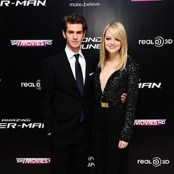Andrew Garfield and Emma Stone have adopted a dog together