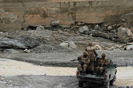 Pakistani soldiers drive through a stream during their patrol at Wana Jandola road near Wana. Photo: Reuters