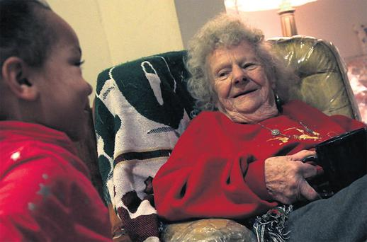Josephine Stout with great-granddaughter Jolisa Stidhum at home in Chicago