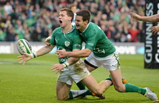 24 November 2012; Craig Gilroy, Ireland, celebrates after going over to score his side's first try with team-mate Jonathan Sexton, right. Autumn International, Ireland v Argentina, Aviva Stadium, Lansdowne Road, Dublin. Picture credit: Stephen McCarthy / SPORTSFILE