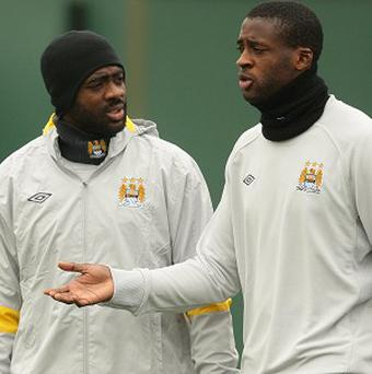Kolo, left, and Yaya Toure, right, head to South Africa to play in the African Nations Cup with Ivory Coast next month