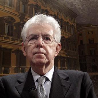 Italian Premier Mario Monti speaks during a press conference at the Italian Senate in Rome (AP)