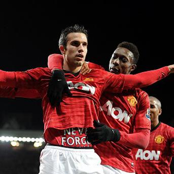 Robin van Persie celebrates scoring his side's second goal