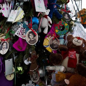 Nouel Alba is accused of posing as a family member of one of the Sandy Hook victims to swindle money (AP)