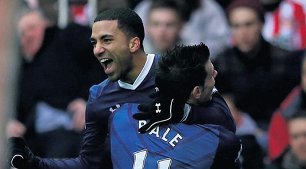 Tottenham's Aaron Lennon celebrates scoring his team's second goal with Gareth Bale