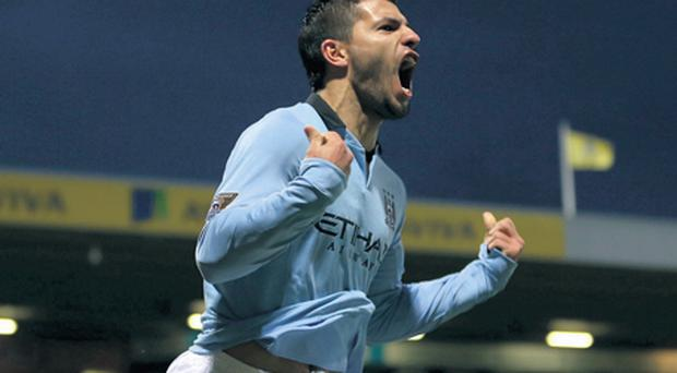 Sergio Aguero of Manchester City celebrates scoring his side's third goal during the Premier League match against Norwich City