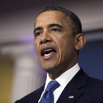 Barack Obama says he will put his full weight behind legislation to tackle gun violence