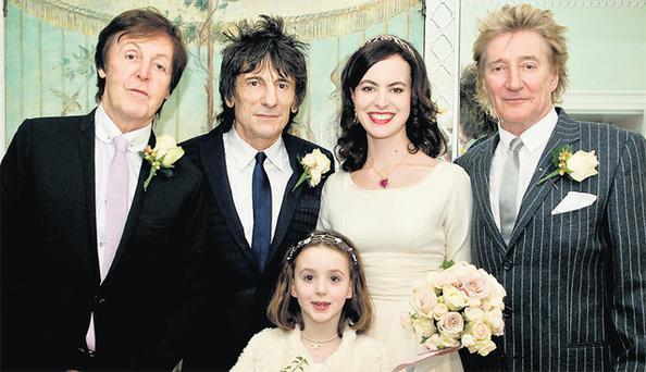 Rolling Stone Ronnie Wood (65) poses with his bride Sally Humphreys (35) surrounded by his rock star best men – fellow rockers Paul McCartney and Rod Stewart