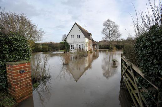 A house is surrounded by floodwater near Apperley in Gloucestershire, after days of almost relentless downpours
