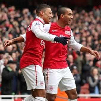 Alex Oxlade-Chamberlain, left, believes Theo Walcott, right, has proven his ability to lead Arsenal's attack