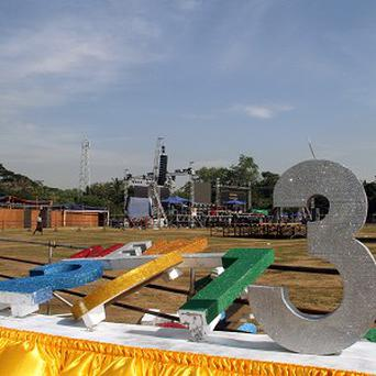 Workers in Yangon set up a stage for Burma's first ever public new year countdown celebration (AP)