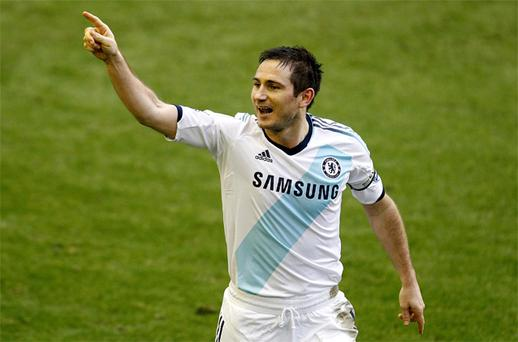 Chelsea's Frank Lampard celebrates after scoring his side's second goal against Everton at Goodison