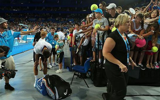 Taking a breather: Novak Djokovic takes a second to compose himself after a railing fell on him while fans tried to get his autograph. Photo: Getty Images
