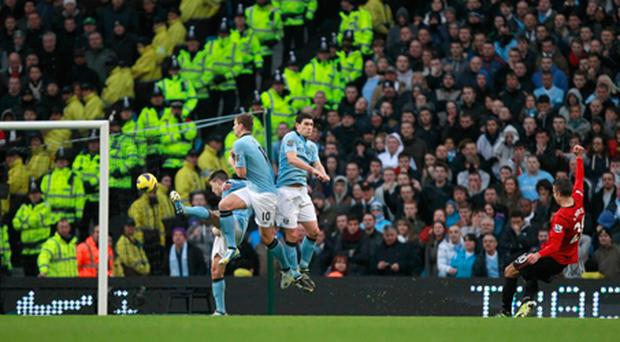 Robin van Persie hits the free-kick which helped Manchester United beat Manchester City 3-2 last month