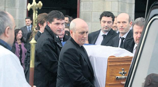 The remains of Frankie Walsh are taken from the church.