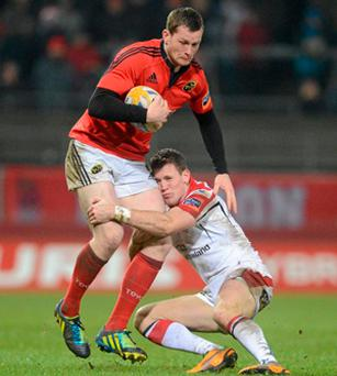Munster's Denis Hurley takes on Craig Gilroy of Ulster during their Pro 12 clash