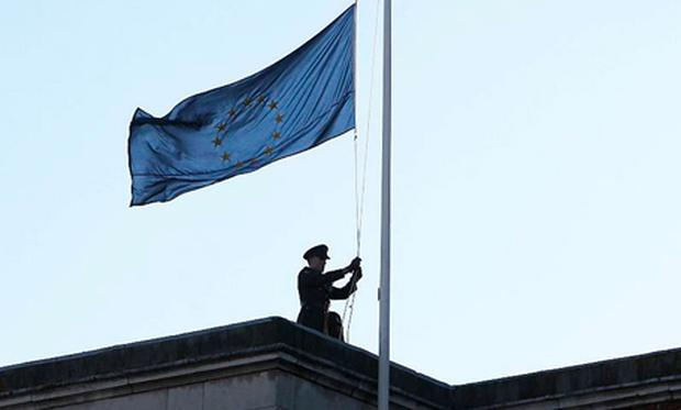 A soldier raises the EU flag over Dublin Castle, to mark the beginning of the Irish presidency of the European Union.