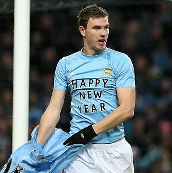 Edin Dzeko celebrates scoring City's second goal
