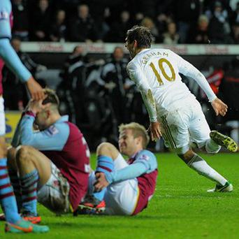 Danny Graham celebrates snatching a point for Swansea against Villa