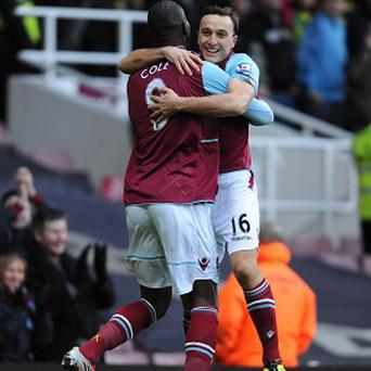 Mark Noble, right, scored a penalty as West Ham beat Norwich