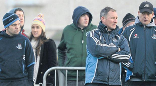 Former world boxing champion Bernard Dunne, left, on the sideline with Dublin manager Jim Gavin and selector Declan Darcy at the Evening Herald Dubs Stars challenge