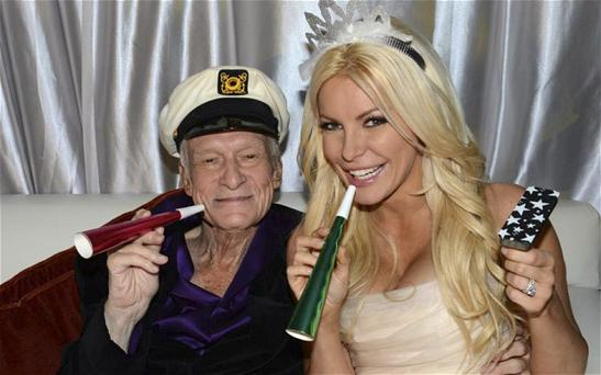 Playboy founder Hugh Hefner poses with his bride Crystal Harris at their wedding at the Playboy Mansion in Beverly Hills, California.