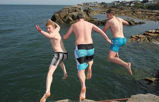 Boys enjoying the warm weather at the Forty Foot, Sandycove last summer on one of the rare hot days.