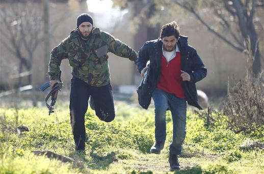 Free Syrian Army fighters run for cover at the front line near Menagh military airport in north Aleppo. Photo: Reuters