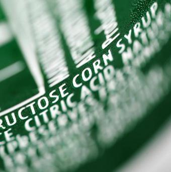 High fructose corn syrup is listed as an ingredient on a can of soda (AP/Matt Rourke)