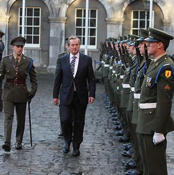 Taoiseach Enda Kenny reviews a Guard of Honour at Dublin Castle as the country marked the beginning of its presidency of the European Union
