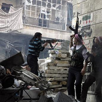Syrian rebels on the attack in Aleppo (AP)