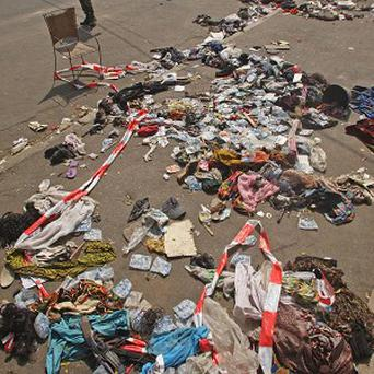 The belongings of people that were involved in a stampede on the ground in Abidjan, Ivory Coast (AP/Emanuel Ekra)