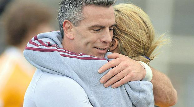 Padraic Joyce embraces his wife after Galway's defeat to Antrim in his last appearance in the maroon jersey